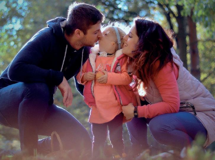 Beatka, trpící TCS, s rodiči